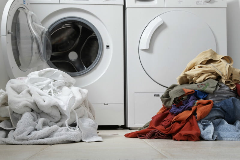 how to wash your clothes laundry tips separating lights and darks getty images